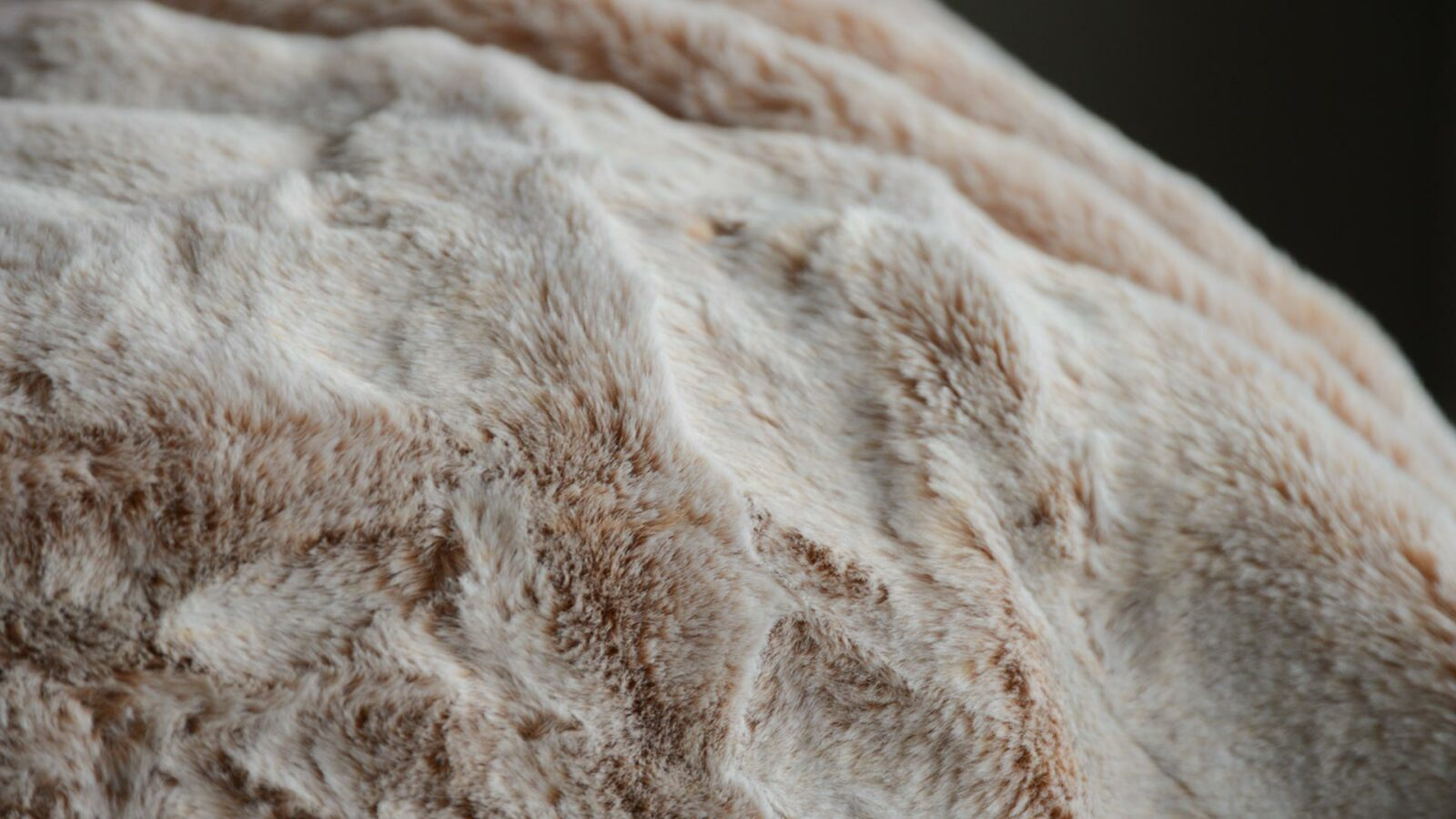 Detail view of the frosted pink faux fur throw