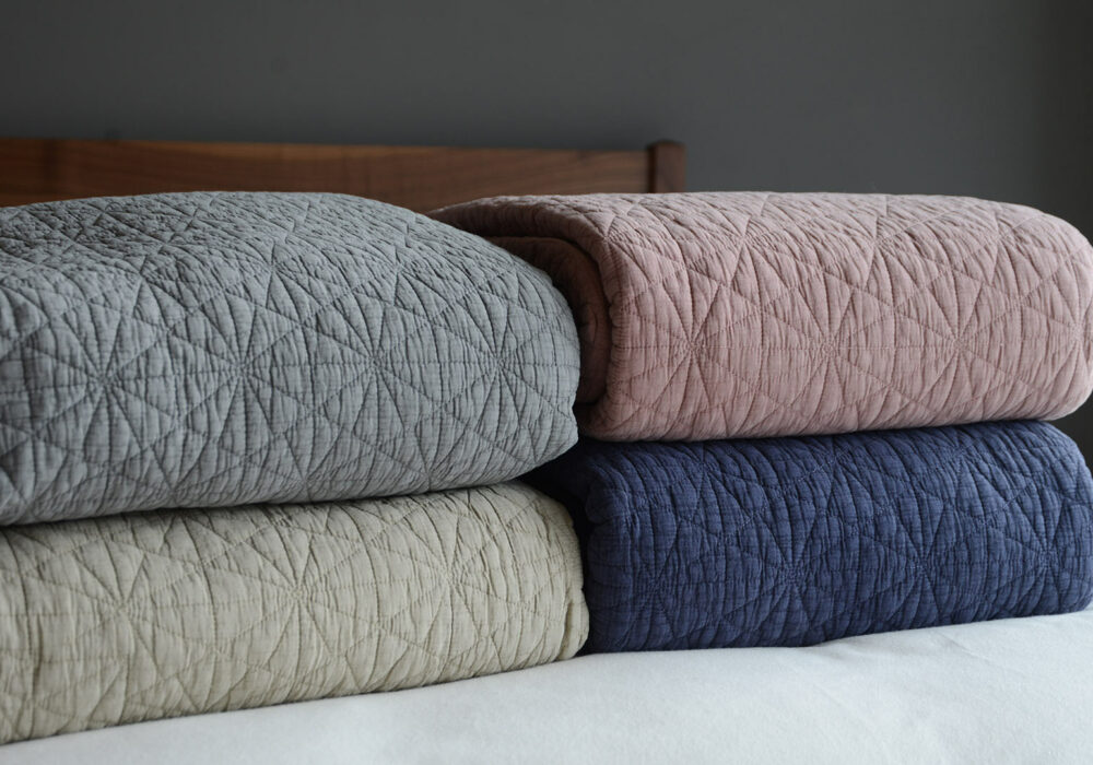 Colour options for the hexagon stitched quilted bedspreads - grey, stone, blush pink, blue