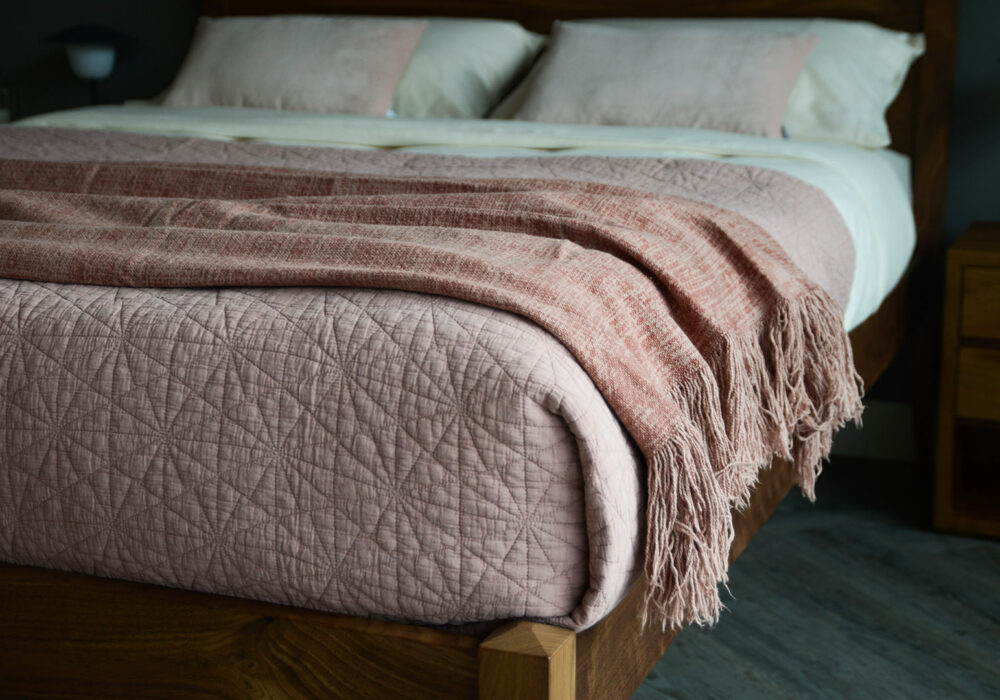 blush pink hexagon stitched quilted bedspread