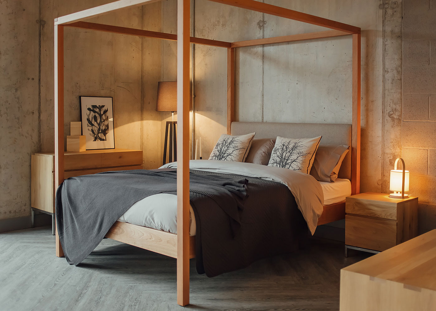 Cosy concrete bedroom featuring our hand-made Highland solid wood upholstered 4 Poster bed in cherry