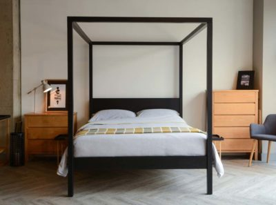 Introducing our black four poster wooden bed - the Black Orchid