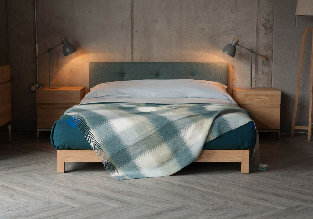 Iona a low solid wooden framed bed with an upholstered headboard. To order in a full range of bed sizes.