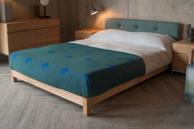 Angled view of British made Iona low upholstered bed