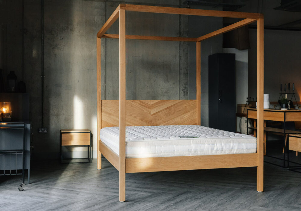 A view of the Kelham contemporary wooden 4 Poster bed shown without bedding