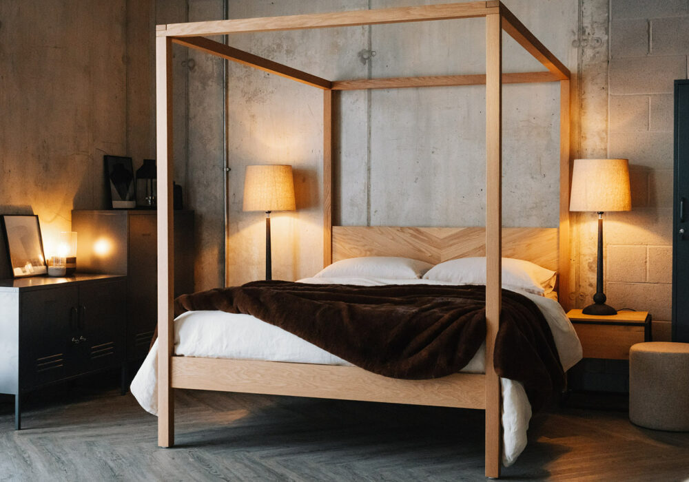 Loft style bedroom with handmade solid wood contemporary 4 poster bed - Kelham