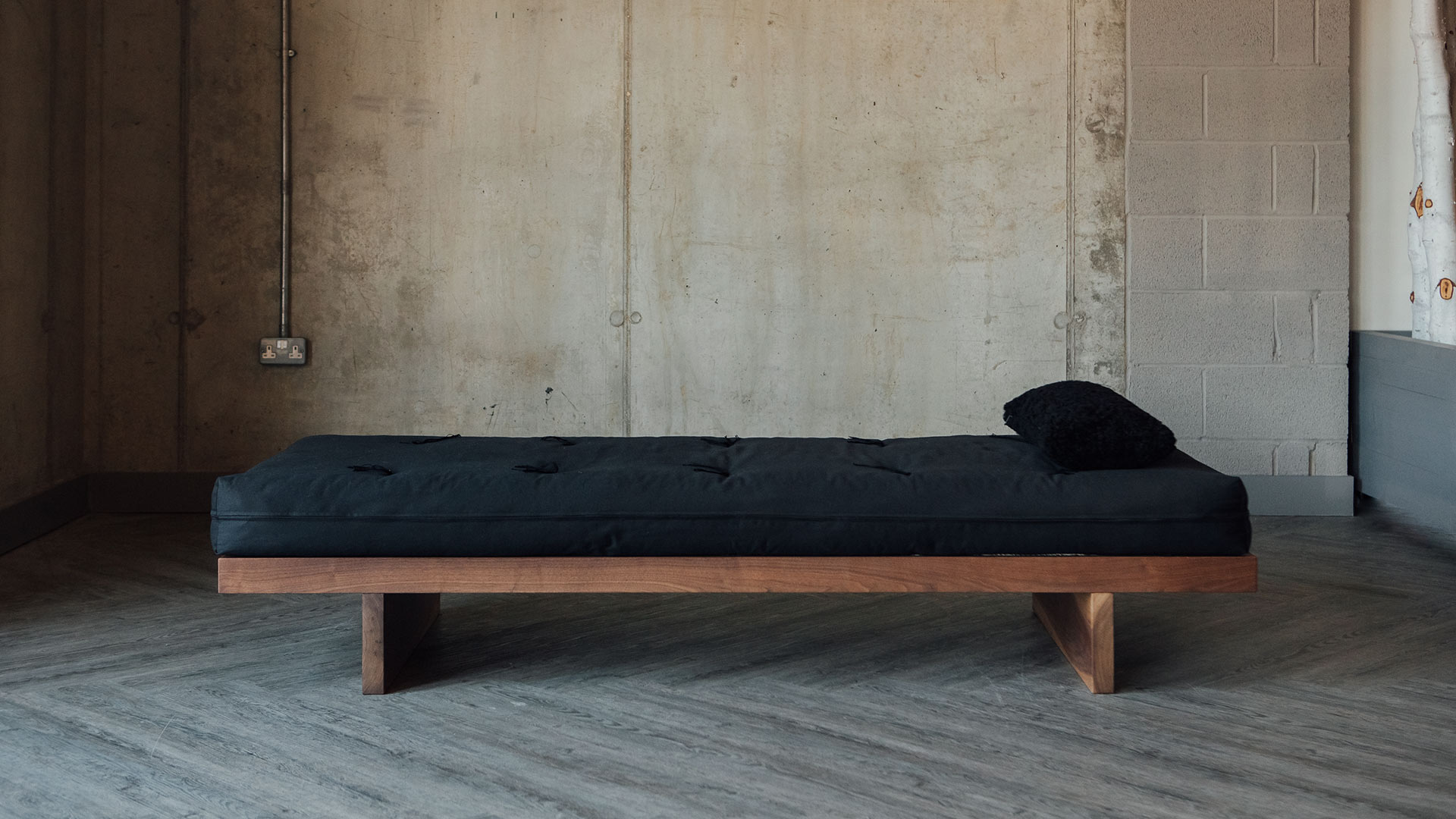 The Kyoto day-bed - its solid wood frame comes in a range of wood options. This is walnut.