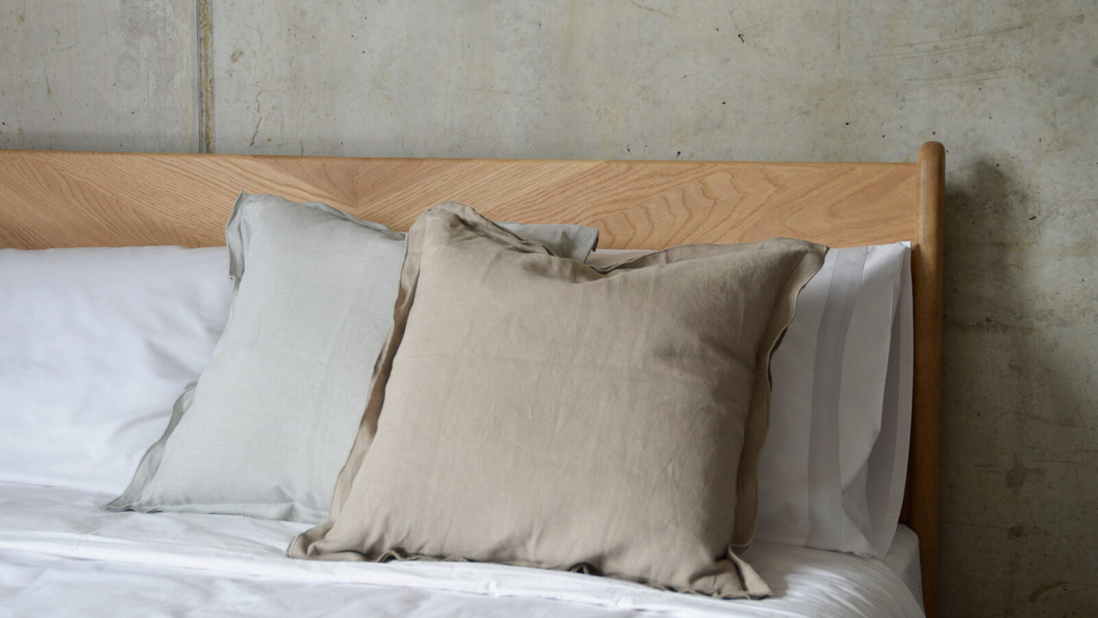 linen ruffle edge cushions in a choice of pale grey or taupe