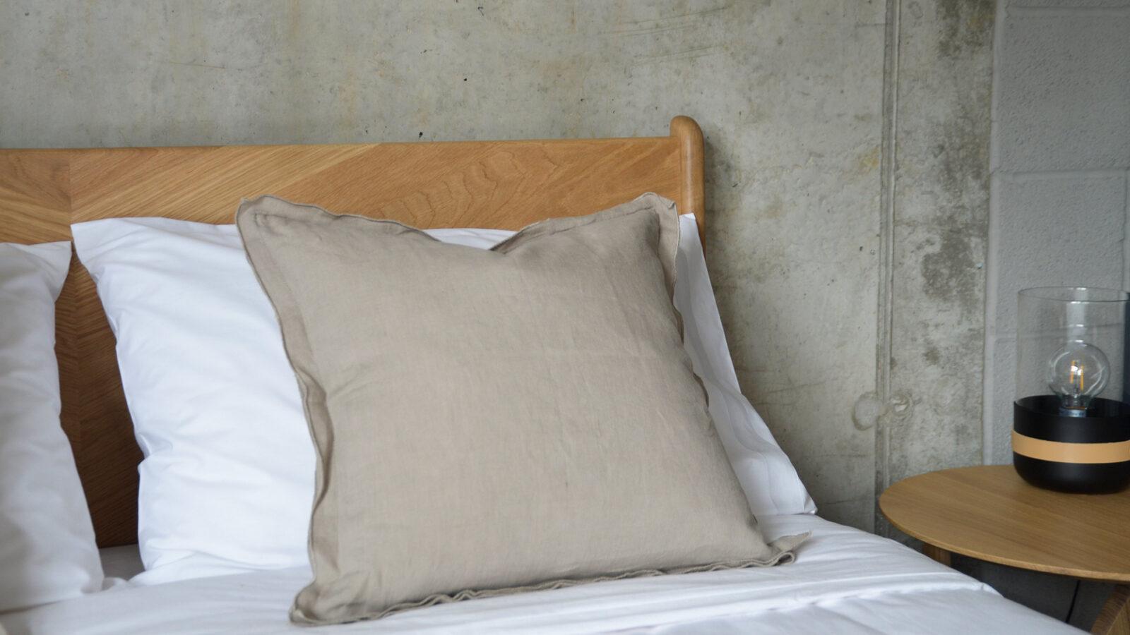 Linen ruffle edge cushion in taupe