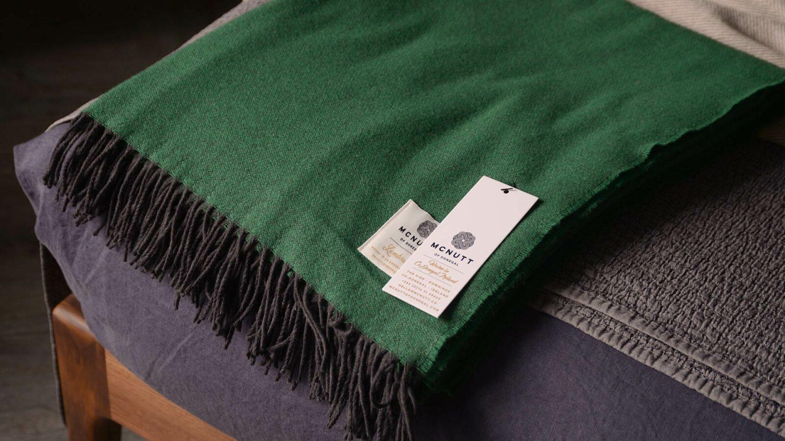 emerald green merino lambswool throw with dark fringing