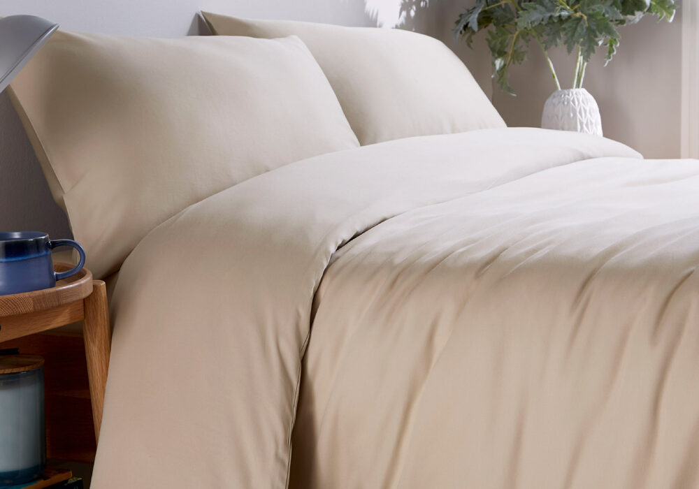 natural stone coloured organic cotton bedding 300 thread count shown on a bed
