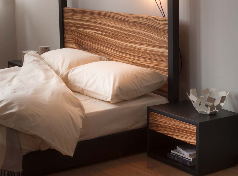 Organic bedding on the Cube 4 poster bed made in Black Oak and Zebrano wood.