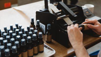 Hand Labelling Parfum Bottle