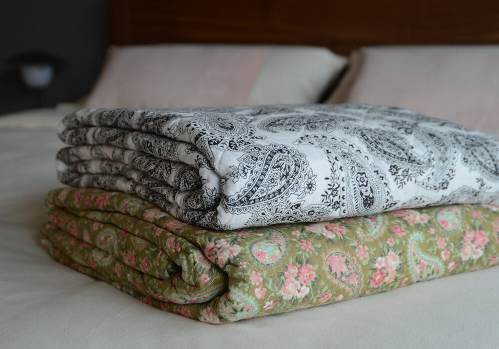 Black & White, and Green Paisley Patterned Quilts