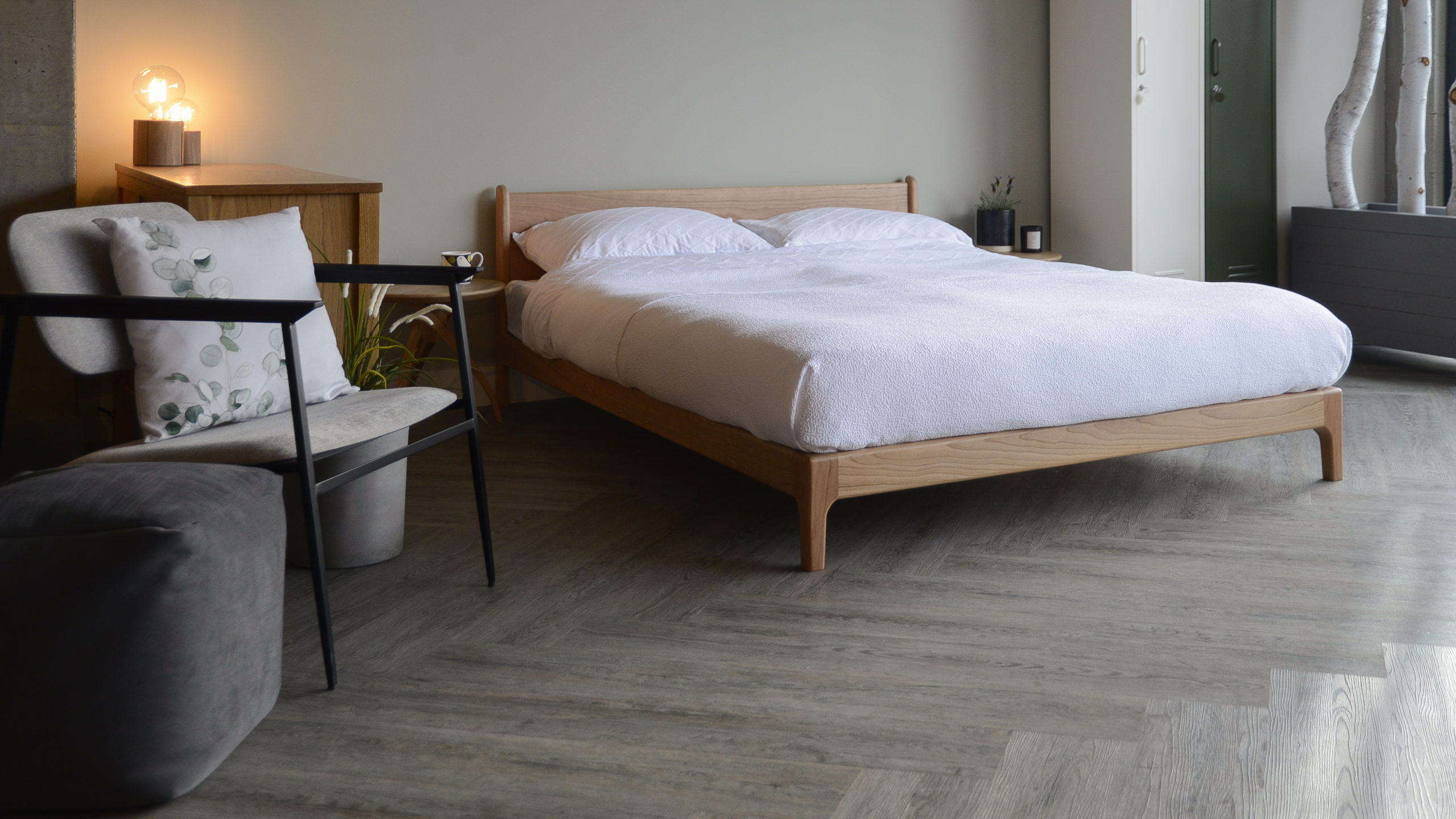 Spring bedroom look featuring the Pimlico bed, a low midcentury style wooden bed, here in cherry