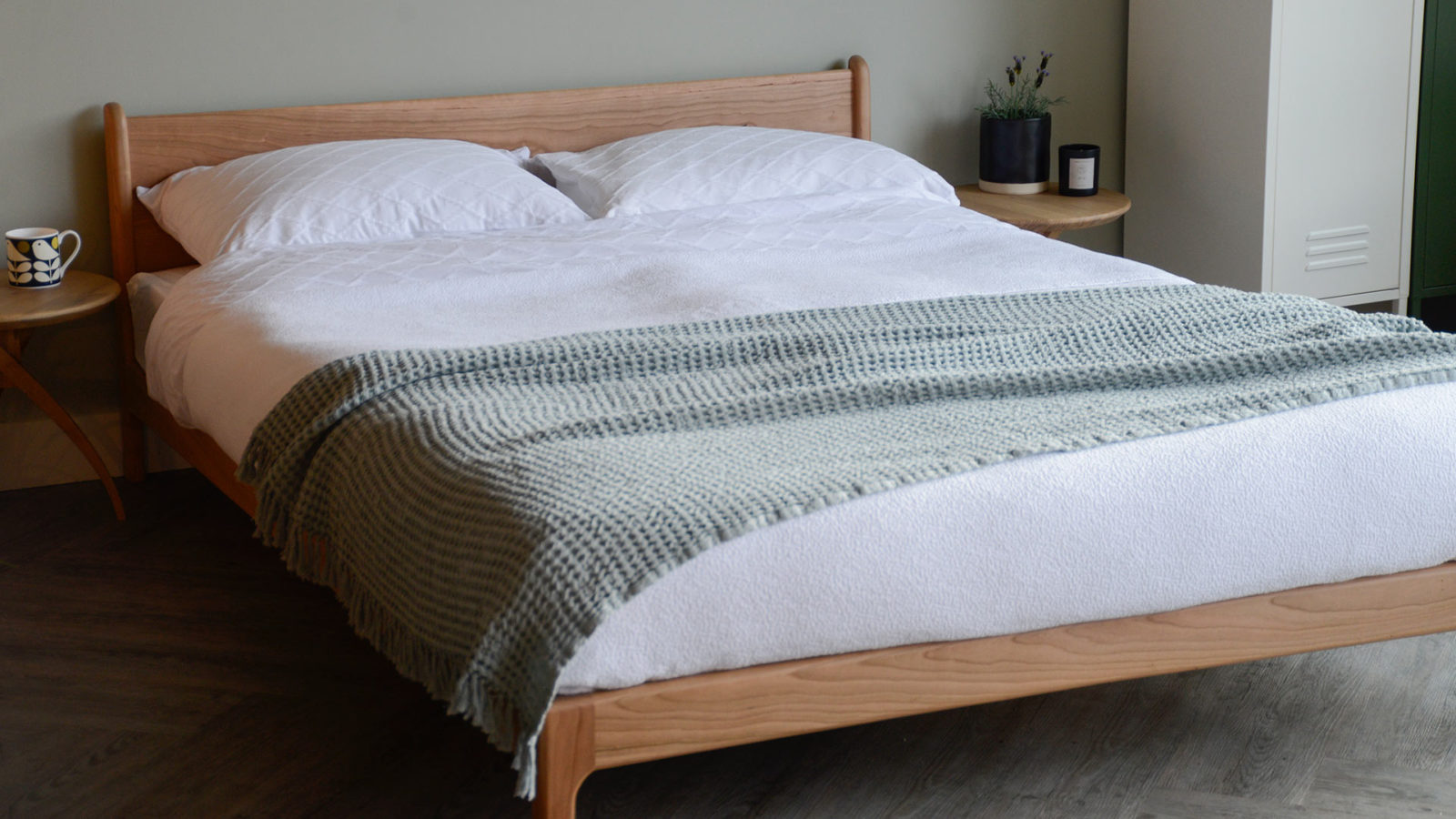 Fresh spring bedding look on the low, solid wood Pimlico bed made in cherry
