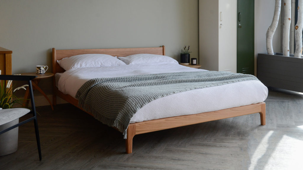 Summer fresh bedroom with our British made Low cherry wood bed - the Pimlico