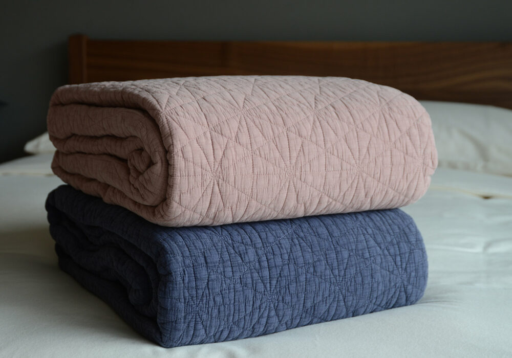 blush pink and blue versions of the hexagon stitched quilted bedspreads