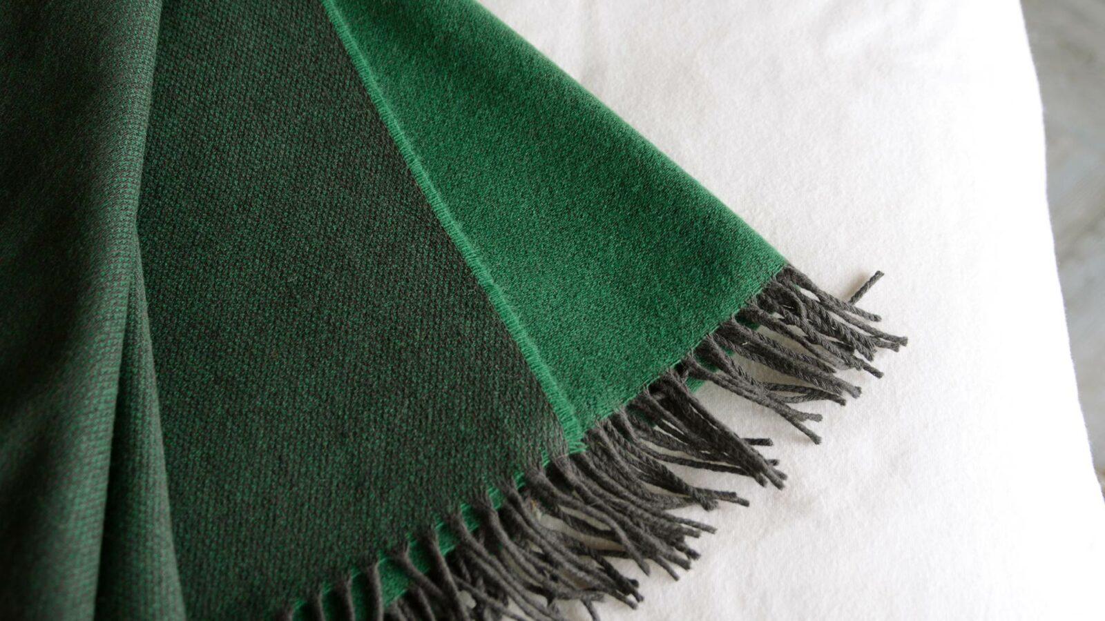 reversible emerald green merino lambswool throw with dark fringing