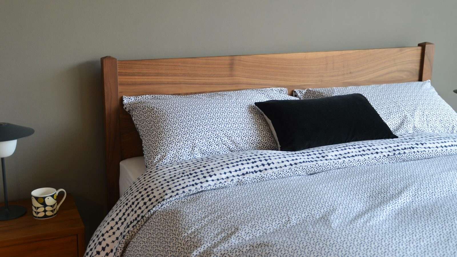 monochrome abstract print duvet cover set shown on our walnut wood Cochin bed
