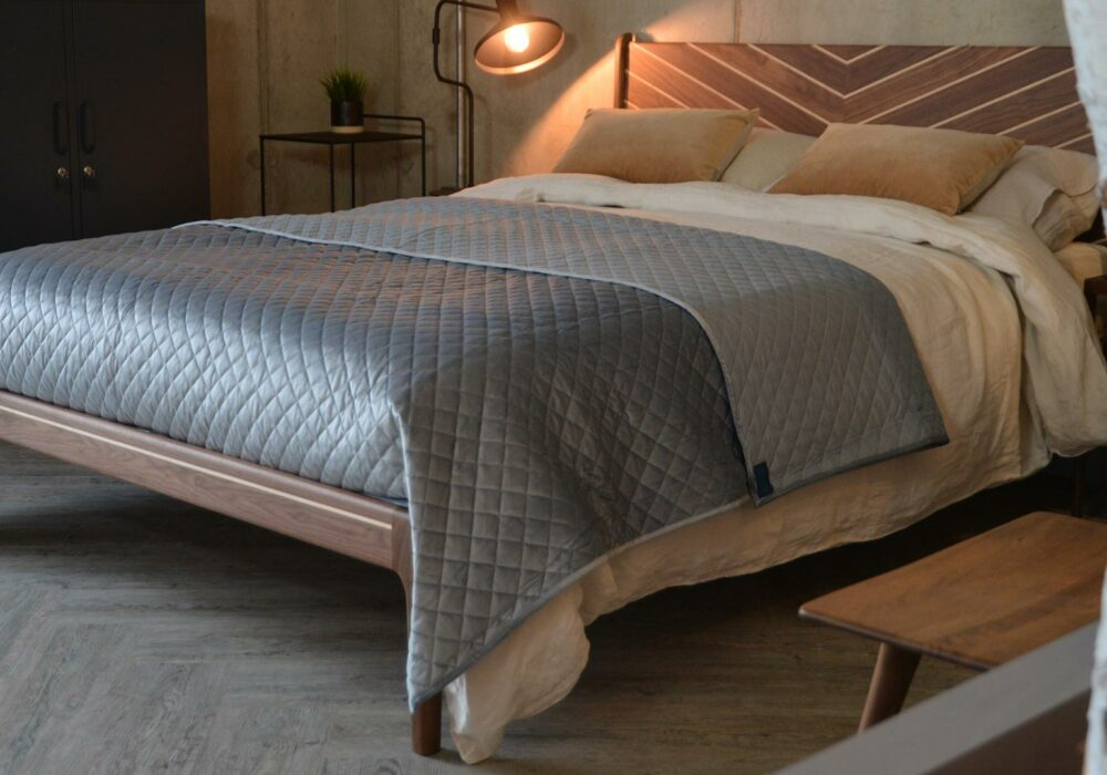 Reversible silver grey velvet-look quilted bedspread on a Kingsize Special Hoxton bed