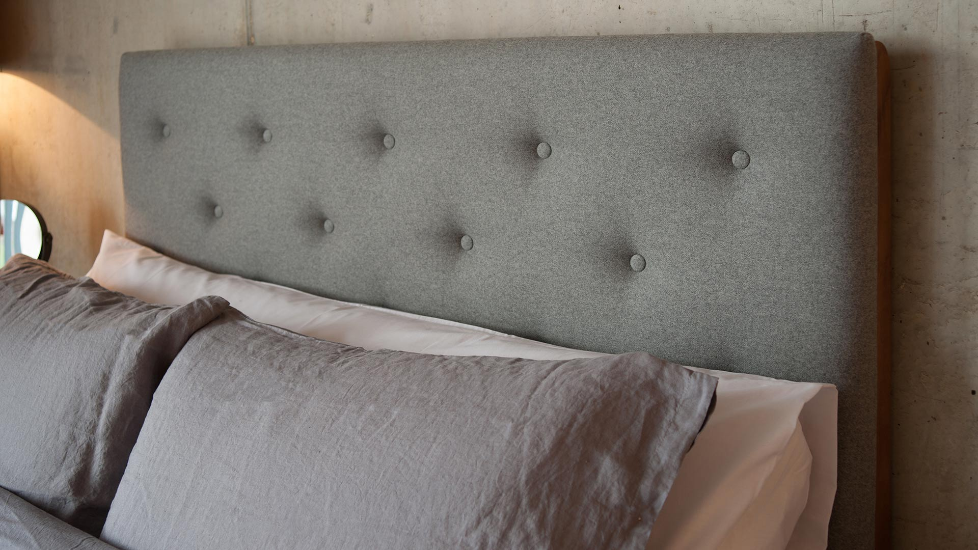 Skye wooden bed tall buttoned headboard close-up