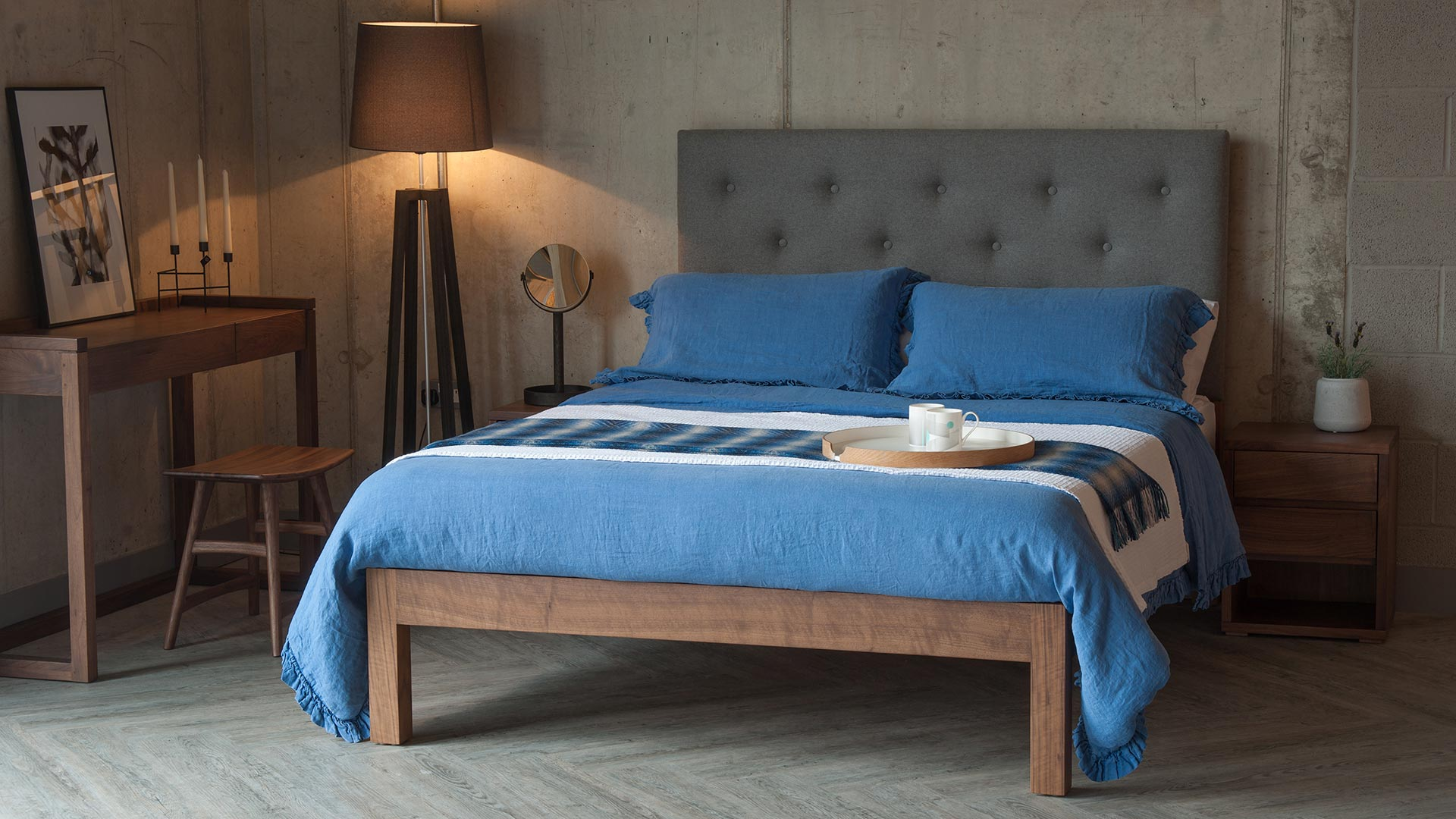 Skye bed with tall buttoned headboard & blue linen bedding