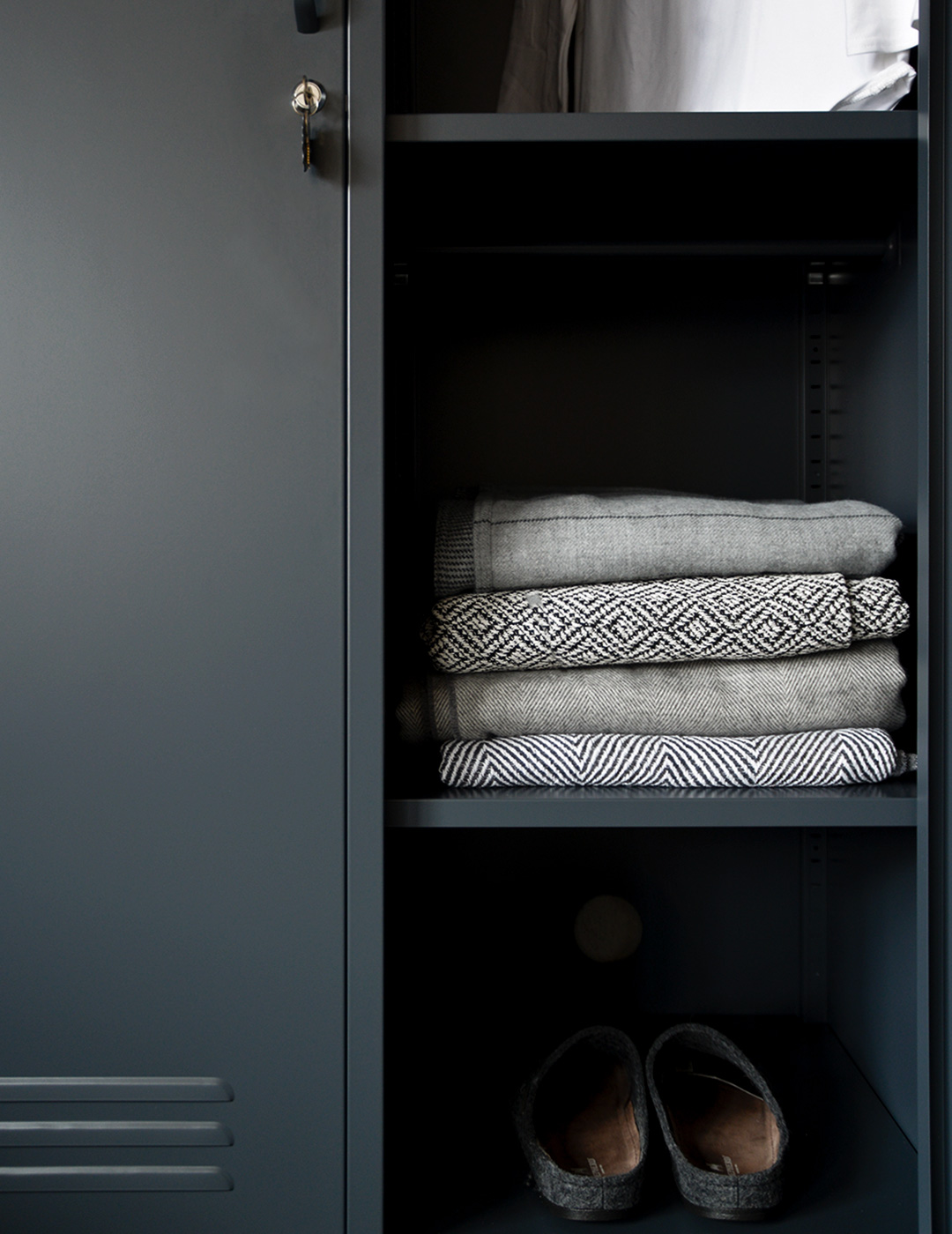 wardrobe metal storage locker in slate grey shown close up with one door open