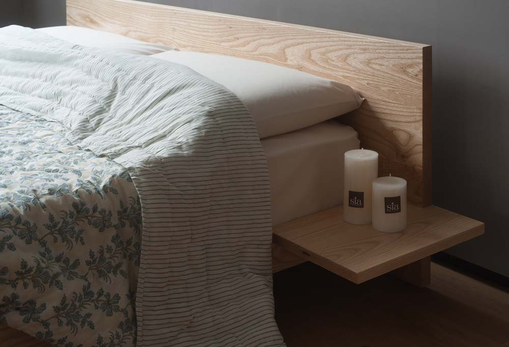 A closer view of our ash wood Kulu Japanese style bed where the headboard and optional side table join.