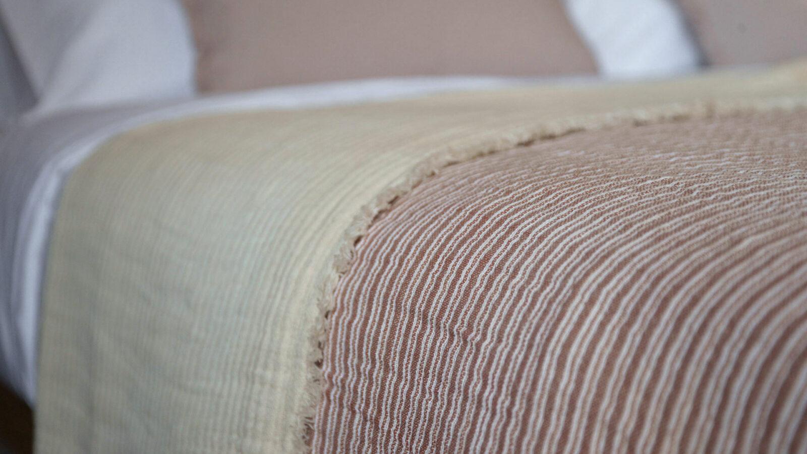 Reversible cotton bedspread pink striped one side plain cream reverse