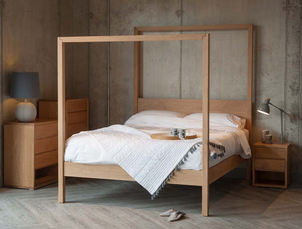 The Oasis Modern solid wood Canopy Bed shown in Oak