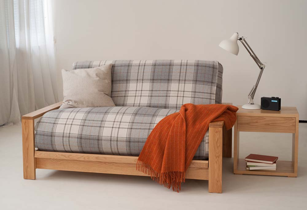 The Panama Sofa Bed in Oak supplied with futon mattress for sitting and sleeping