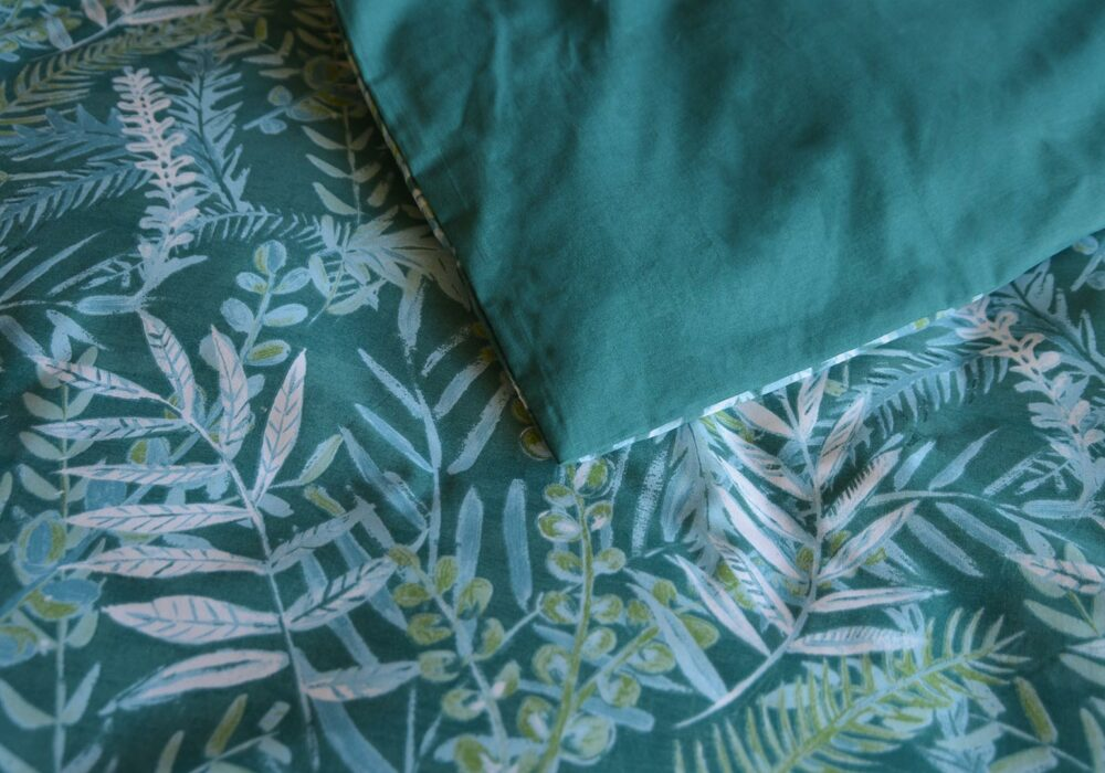 Teal-coloured tropical leaves print duvet cover set a closer view