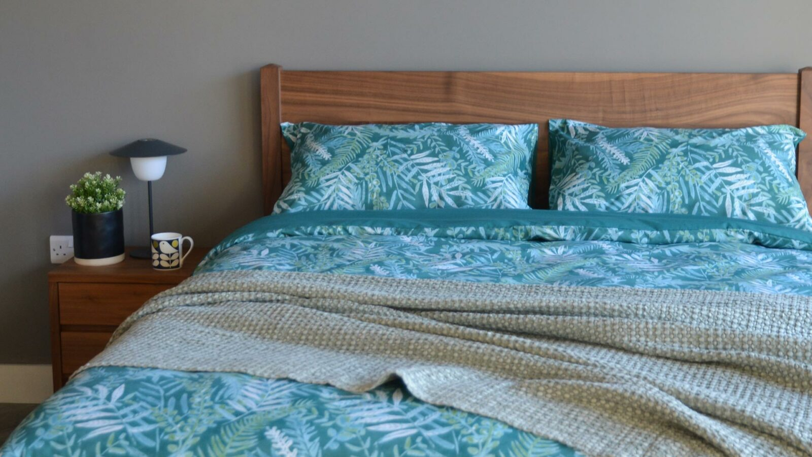 Teal-coloured tropical leaves print duvet cover set on our walnut wood Cochin bed fame
