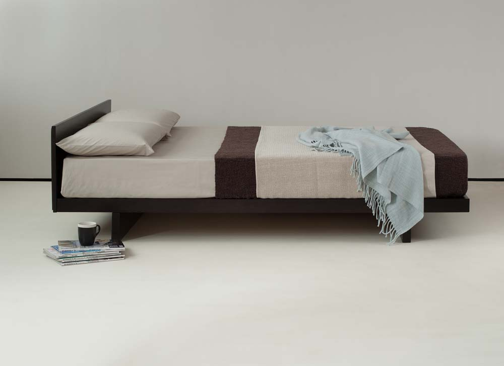Low Japanese style bed or futon base - the Kobe, here shown in Solid Pine with Wenge stain finish
