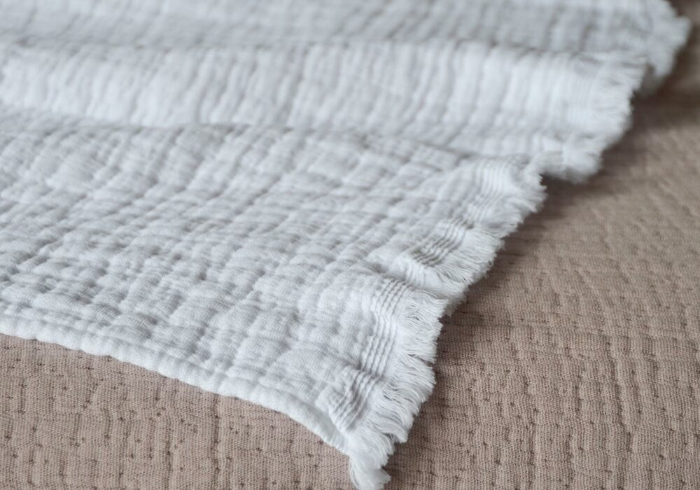 Pure cotton crinkled effect white throw up close to show fringed edge