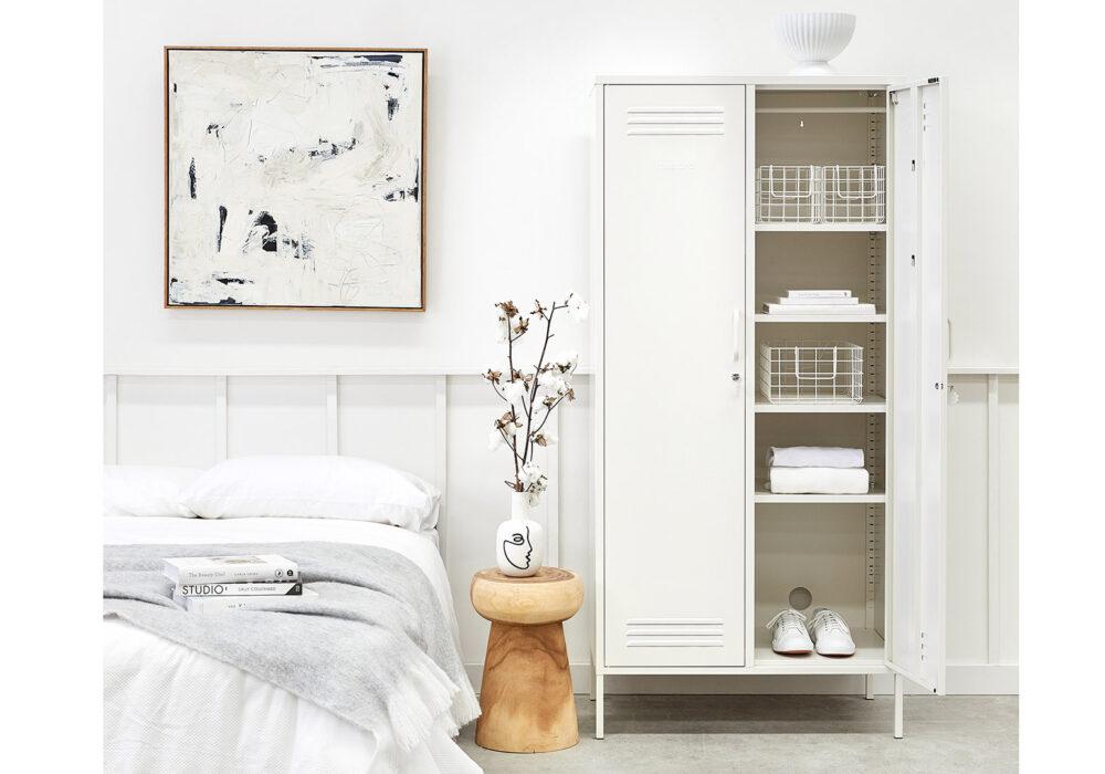 wardrobe storage locker in white shown with one door open