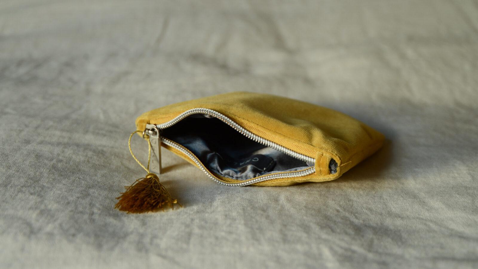 Velvet zipped purse in mustard yellow