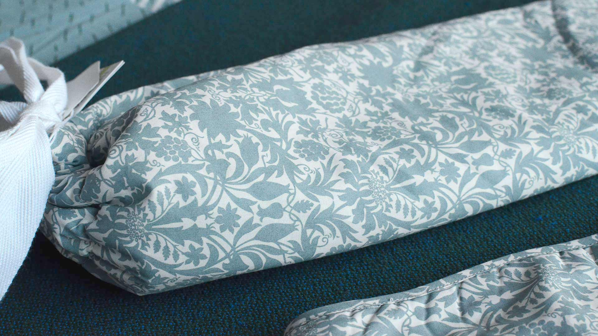 Long therapeutic hotwater bottle with liberty print cotton cover