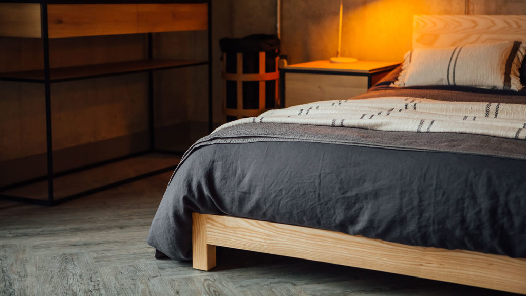 A closer view of the low chunky solid wood Sonora beds leg and foot end, here in Ash