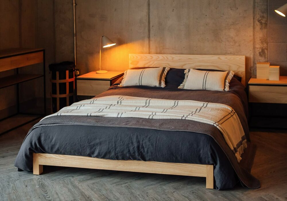 Dark slate bedding on our pale Ash low wooden Sonora bed - Nordic style bedroom