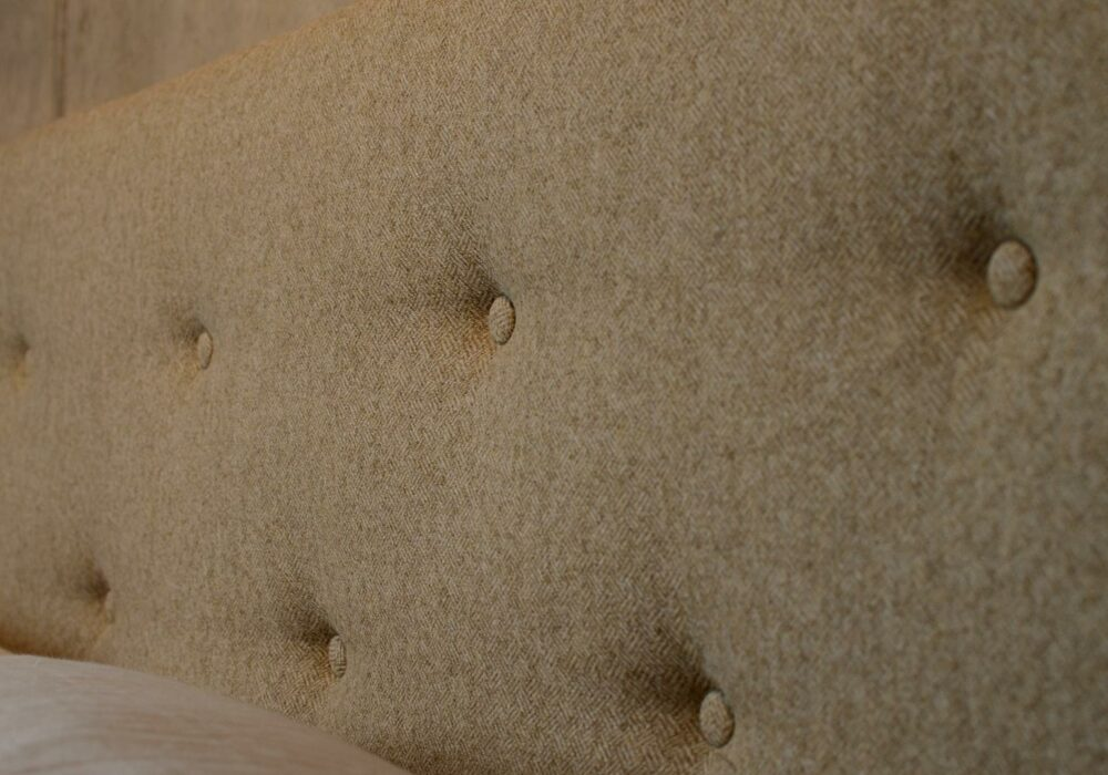a closer view of the buttoned wool fabric Arran bed headboard