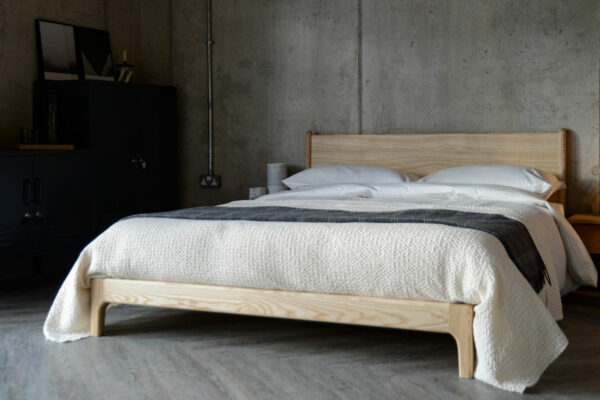 Industrial bedroom look featuring the pale ash Carnaby bed, a low hand crafted wooden bed
