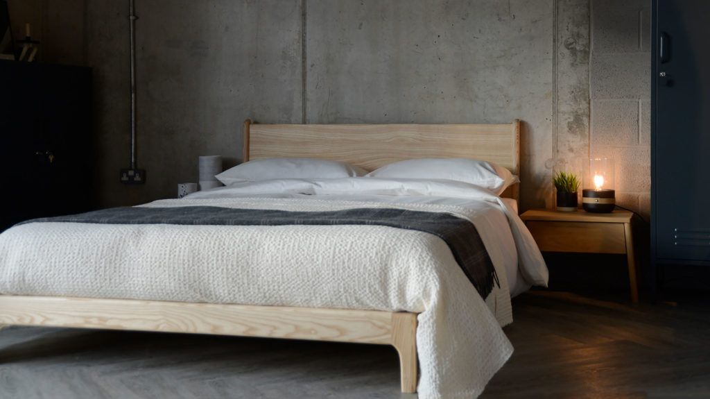 Scandi style bedroom with low wooden Carnaby bed in solid ash