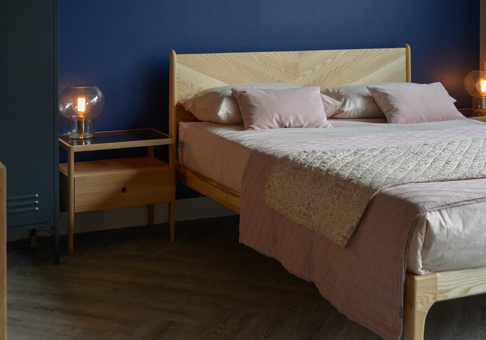 Hand crafted wooden Hoxton bed in Ash with striking chevron pattern headboard.