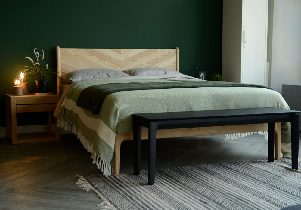 black painted solid oak bench or end of bed table shown in a bedroom setting
