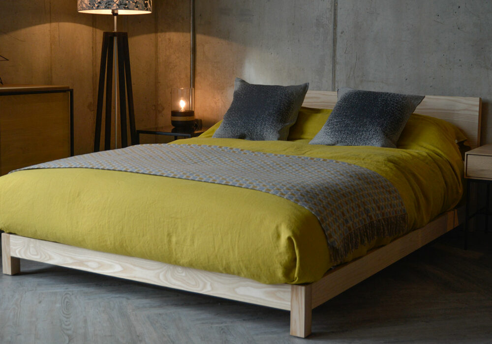 Sonora a contemporary chunky low wooden hand crafted bed, here in Ash