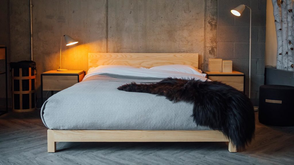 Textured grey bedspread on our ultra low solid wood Sonora bed great for loft spaces and low ceilings