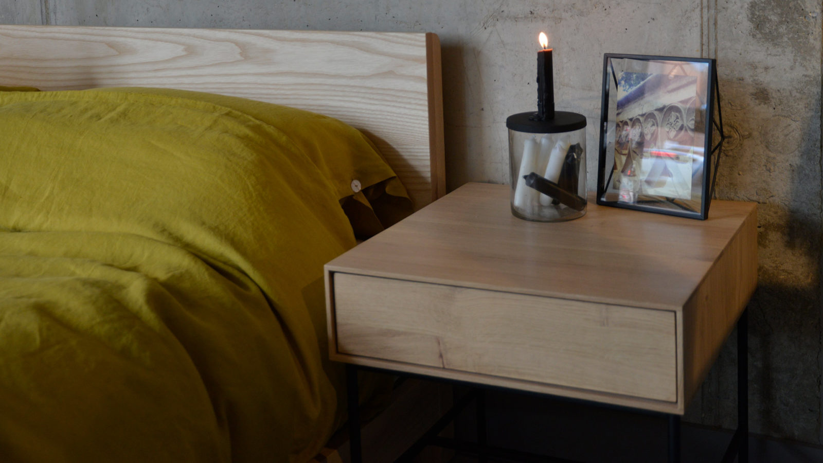 Ash Sonora bed headboard shown with Whitebird bedside table