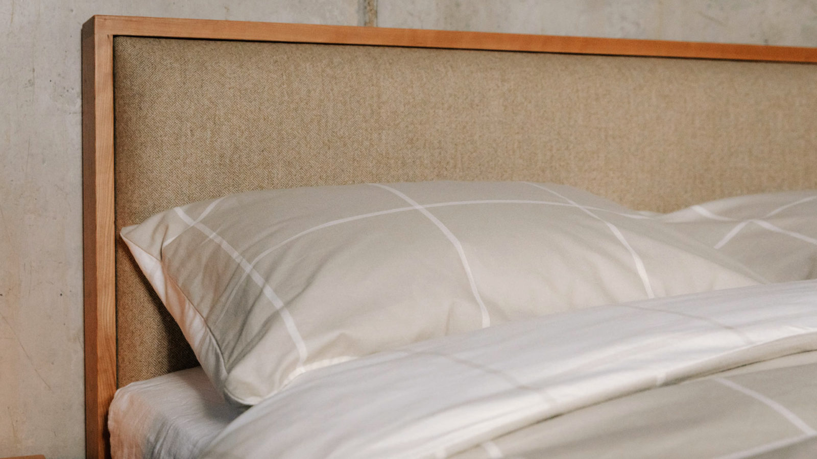 brushed cotton bedding in beige and ivory against Shetland wooden bed padded headboard