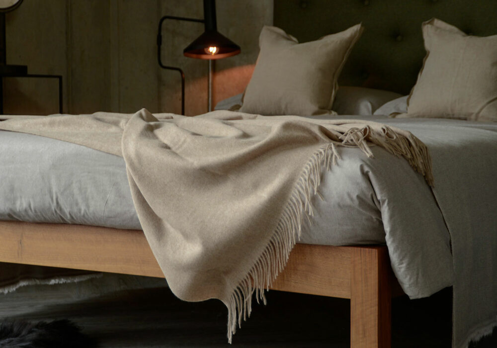 soft recycled wool fringed throw in pale beige